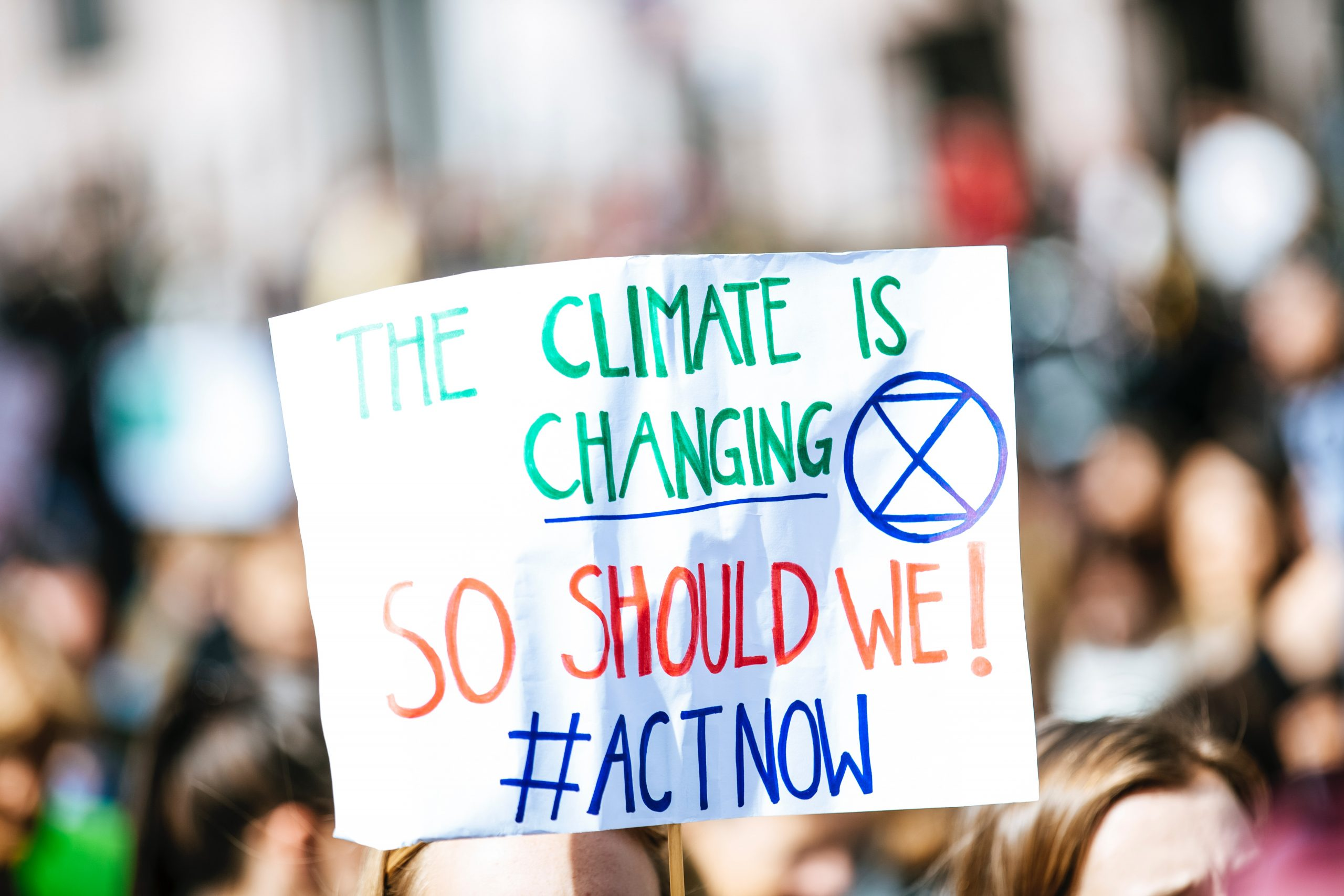 Placard reading 'the climate is change=ing, so should we'