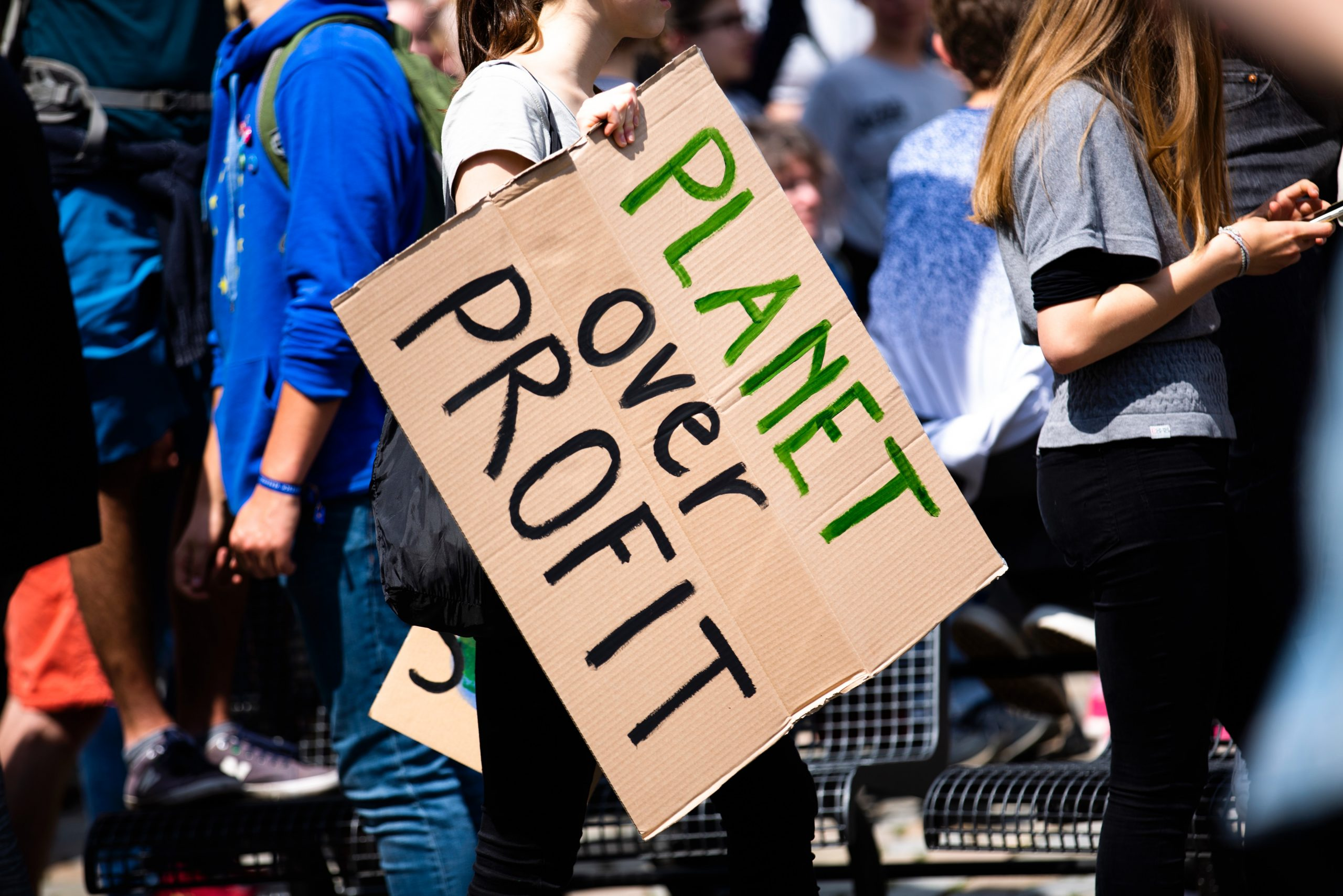 Placard reading 'planet not profit'